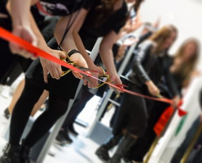 store grand opening - cutting red ribbon