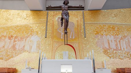 Sanctuary of Fatima, Portugal. Basilica of Most Holy Trinity altar. Crucifix by Catherine Greene and Back Wall by Marko Ivan Rupnik. Fatima is a major Marian Shrine pilgrimage site