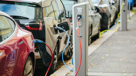 Vehicle with an electric motor. Electric vehicle charging. Eco car.