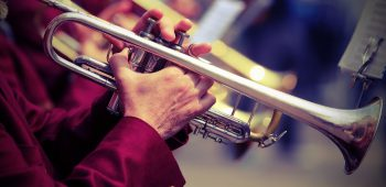 trumpeter plays his trumpet in the brass band during live event