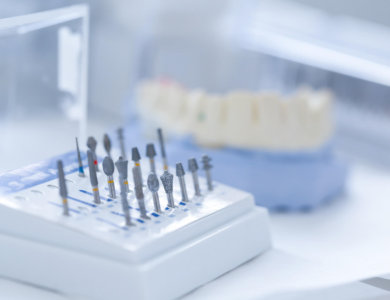 Variety of tools: ceramic preparation kit with dental mold in the background