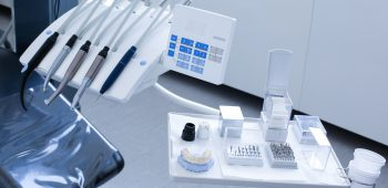 Dentist's office - specialist tools, drills, handpieces and laser with polish nozzles, drill nozzles and denture model on the tray