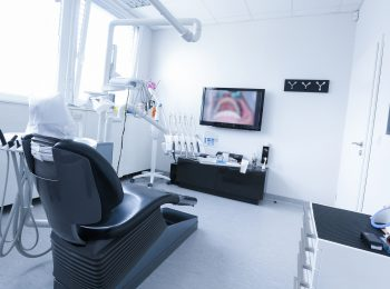 Dentists office with live picture of teeth in the background. Dental care, dental hygiene, checkup and therapy concept.