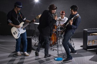 boy band concert in dark