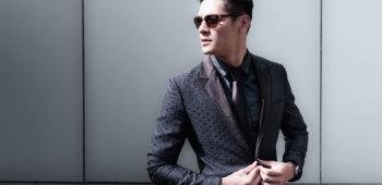 High fashion model wearing suit.