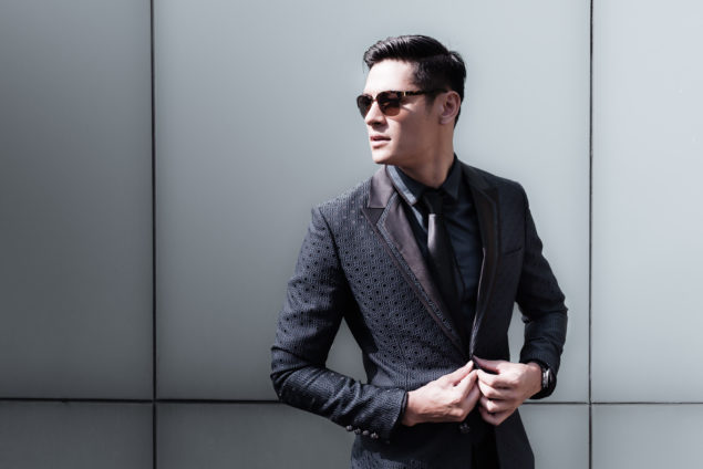 High fashion model wearing suit.